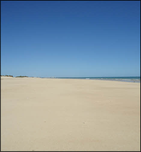empty fabrica beach in the algarve, portugal