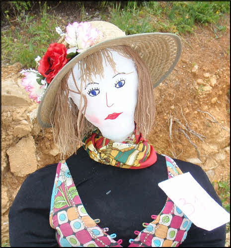 pretty lady with hat in portugal in may