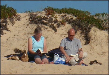 reading on the beach in January