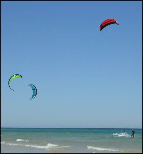 kite surfing at fabrica beach in the algarve portugal